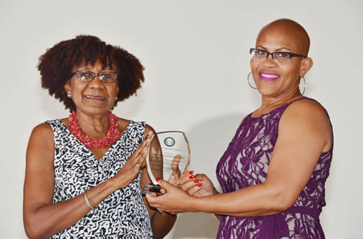 Naoimi De Allie, General Manager – Credit, Republic Bank (Grenada) Limited,  receives one of the Good Corporate Citizen Awards